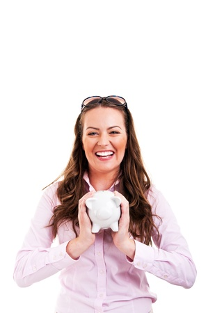 coinbank: Business woman saving money in a piggybank - isolated over a white background Stock Photo