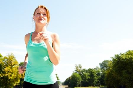 runner - woman running outdoors training for marathon run photo