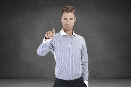 Business Man pushing on a touch screen interface