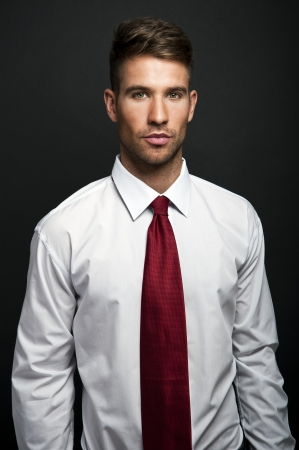 Handsome young businessman standing  photo