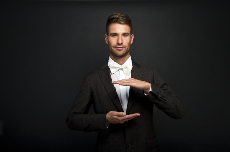 Business man with cupped hands as if holding something.   Stok Fotoğraf