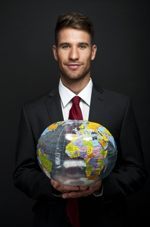 Businessman holds Earth in a hand photo