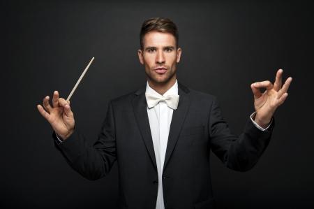 conducting: Man conducting an orchestra