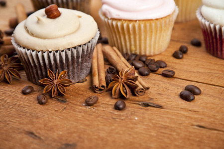 chocolate cupcake, coffee beans, cinnamon, star anise on sacking background. Still, restaurant, coffee shop. photo