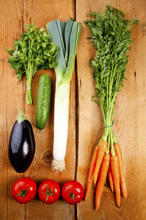 Vegetables on wooden table photo
