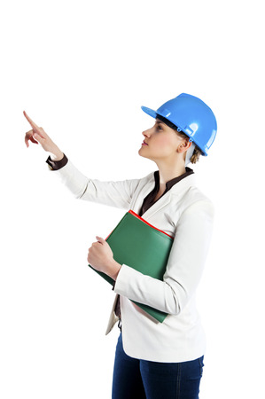 Woman in hardhat pointing finger   photo