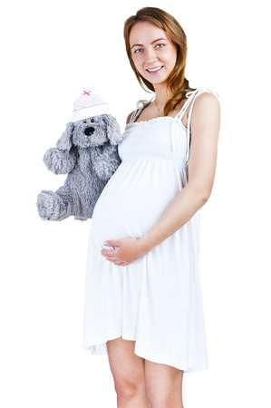 Beautiful pregnant woman - isolated over a white    photo