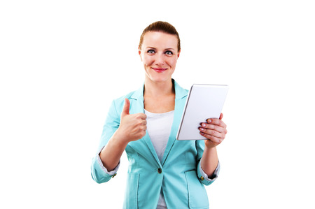 business woman with tablet and thumbs up photo