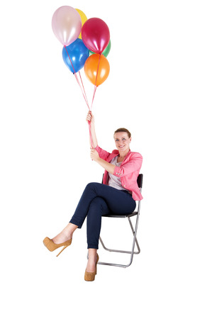 woman with balloons over white background smiling photo