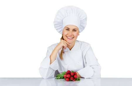 Chef woman. Isolated over white background by the table with vegetable photo