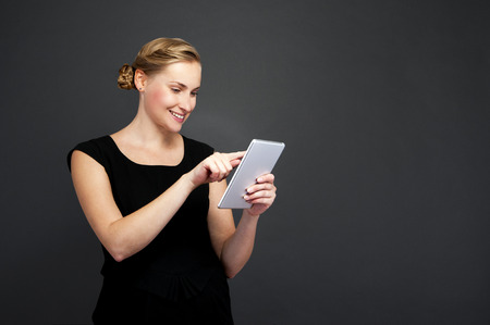 topicality: Smiling woman with tablet computer