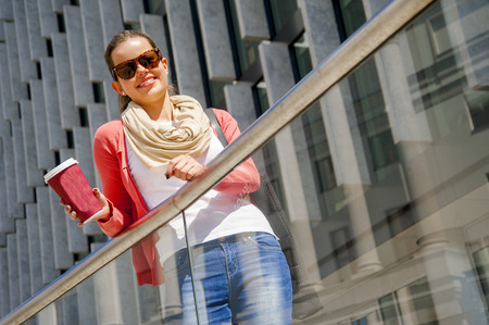 vivacious: Caucasian woman Vivacious in City with a beautiful beaming smile backlit by the warm glow of the sun shining down City.