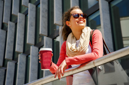 beaming: Caucasian woman Vivacious in City with a beautiful beaming smile backlit by the warm glow of the sun shining down City.