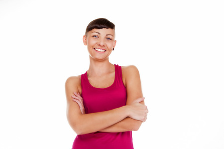 isoleted: Young woman in fitness outfit isoleted over white background smiling. Portrait.