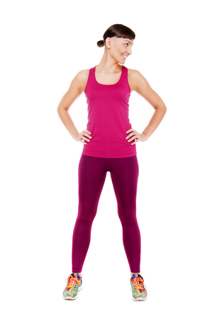 looking aside: Young woman in fitness outfit isoleted on white background smiling and looking aside.