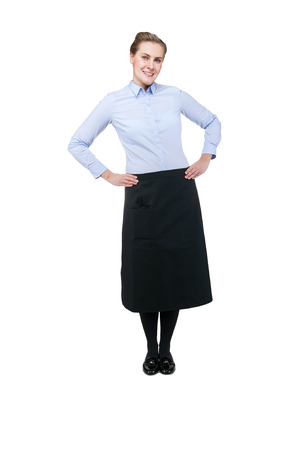salesgirl: Waitress isolated over white background. Smiling blond woman in uniform. Stock Photo