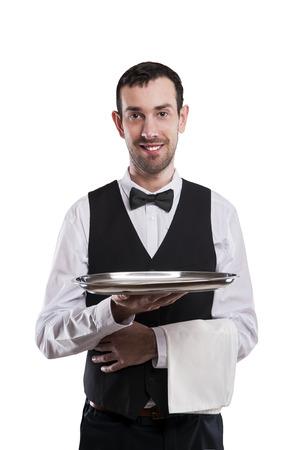 hotel staff: Waiter holding tray. Isolated over white background. Smiling butler. Stock Photo