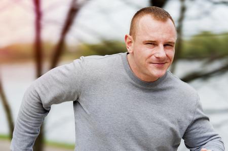 jogger: Man run by the river. Outdoor jogger. Stock Photo