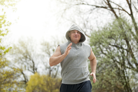 runing: Active man joging in park. Runing fit. Stock Photo