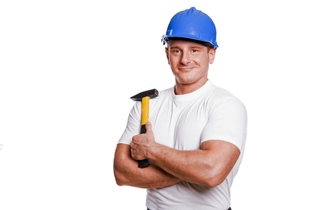 smiling handyman on white background fine portrait. Stock Photo