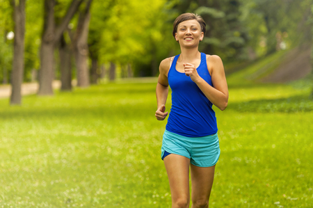 mp3 player: Pretty sporty woman jogging at park