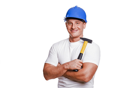 smiling handyman on white background fine portrait. Stock Photo