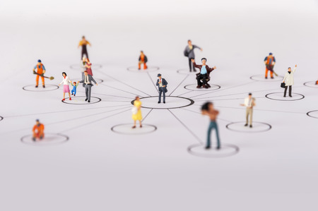 network diagram: close up of miniature people with social network diagram