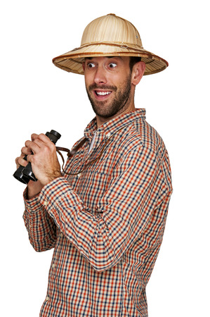 see through: Man looking binoculars with traveler hat isolated over white background.