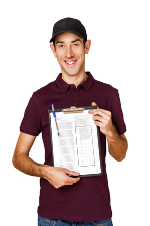 Smiling delivery man holding clipboard on white background