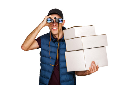Delivery man with mail and binoculars isolated over white background.