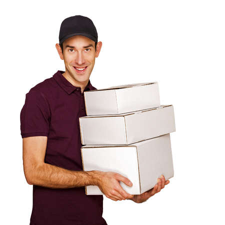 Delivery man with boxes isolated over white background. photo