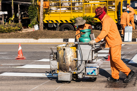 scorching: Road Marking Workers at Work Under Scorching Sun.