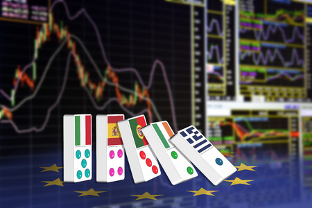 to seem: Five dominoes of EU countries that seem to have financial problem, stand upright in front of the display of financial instruments for stock market technical analysis. Stock Photo