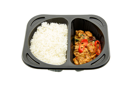 hectic life: Stir-fried basil chicken with Jasmine rice, an innovative instant meal for a hectic life preparing by putting in a microwave just for a few minutes. Found in most famous convenience stores in Thailand. Stock Photo