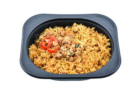 hectic life: Stir-fried basil and pork with fried rice, an innovative instant meal for a hectic life preparing by putting in a microwave for a few minutes. Found in most famous convenience stores in Thailand. Stock Photo