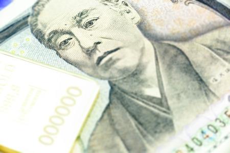 yen note: Japanese one thousand yen note, a macro close-up with gold bullion.
