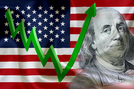 Flag of the United States of America with the face of Benjamin Franklin on US dollar 100 bill and a green arrow indicates the stock market enter booming period.