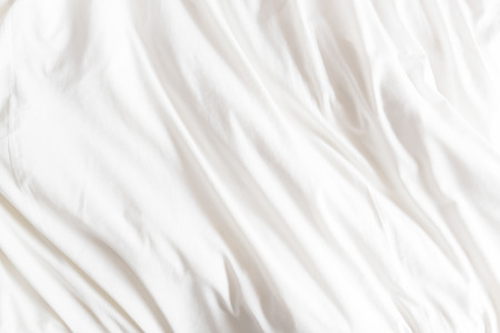 Top view of wrinkles on an unmade bed sheet after waking up in the morning. Stockfoto