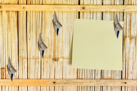 concealed: Blank piece of paper attached on an old house bamboo wooden wall with Japanese ninja concealed weapons. Copy space for leaving several messages when you are not at home i.e. orders, tasks, hints, news