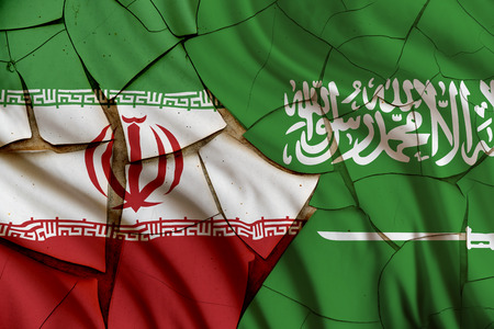Flags of Iran and Saudi Arabia on a cracked paint wall. A symbol of conflict between 2 nations, Tehran and Riyadh which have been strained over different geo-political issues i.e oil export policy,etc Stock Photo