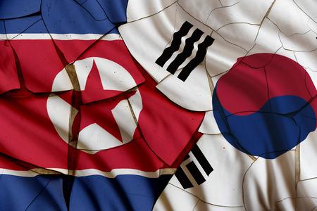 壁のひびの入った塗装に韓国と北朝鮮の旗。ソウルと平壌金正恩軍によって原子核実験といくつかのミサイルのロケットを起動後、2 つの国家間の競
