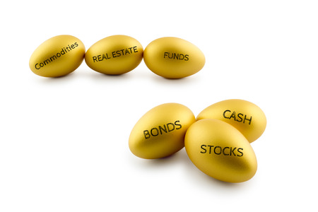commodities: Asset allocation concept, golden eggs with types of financial investment products i.e bonds, stocks, cash, funds, commodities. Long term sustainability wealth management with risk diversification. Stock Photo