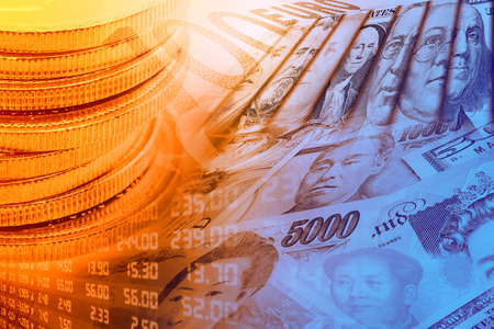 Coins, forex trading panel and portraits / images of famous leaders on banknotes, currencies of the most dominant countries in the world i.e. Japanese yen, US dollar, Chinese yuan, Australian dollar. Standard-Bild