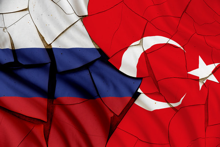 reportedly: Flag of Turkey and Russia. A symbol of an armed conflict between Moscow and Ankara after Russian SU-34 fighter jet or air force plane reportedly flew into Turkish airspace despite radar warnings.