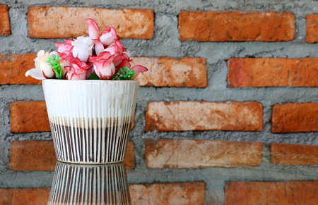Corner of cozy living room artificial flowers for decoration , Vintage style photo