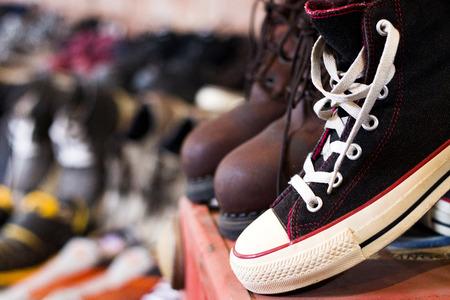 Vintaeg Black shoes in 2nd shop on blury background.