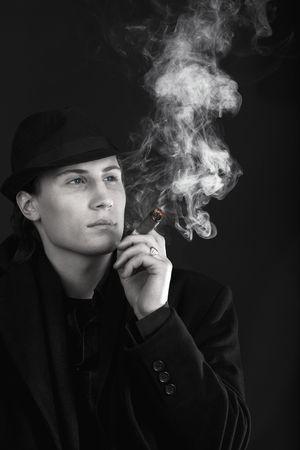 Man in black hat smoke cigar photo