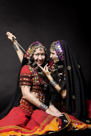 two young woman play with knife photo