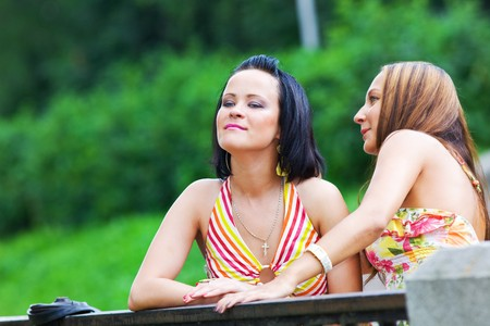 girls tall a secret in park photo