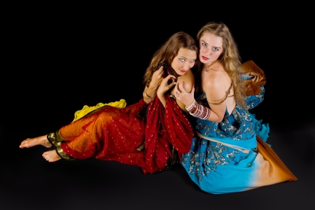 two young attractive woman look at you in indian costume photo